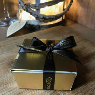 Small chocolate box with decorative ribbon.